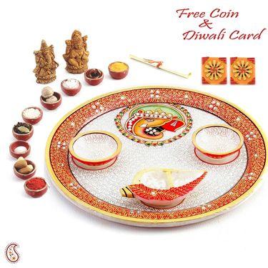 Diyas and Ganeshji seated on a Chowki with Kundans